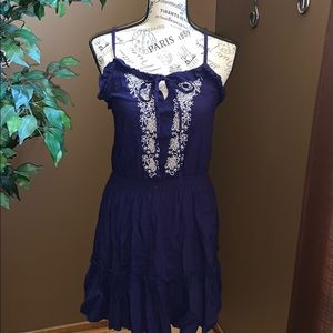 Navy blue dress with white embroidery on front